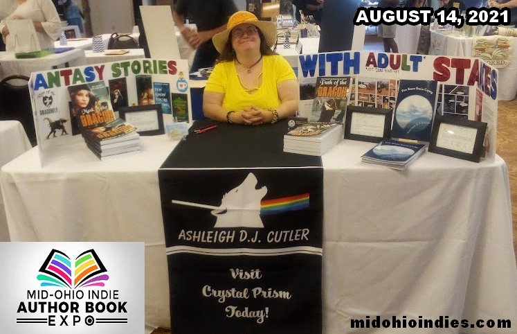 Ashleigh at the Mid-Ohio Indies 2021 with her table of books.